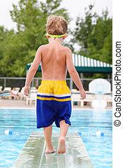 niño joven, en, un, tablero de salto