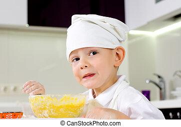 niño joven, en, un, toque, aprendizaje, cómo, a, cocinero