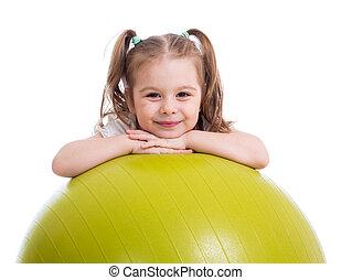 niño, niña, tener diversión, con, pelota gimnástica, aislado