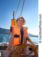 niño pequeño, en, velero, rueda