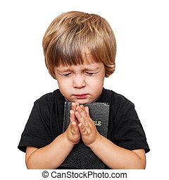 niño pequeño, rezando