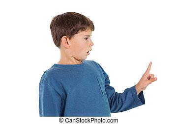 niño, poco, sorprendido, señalar con el dedo arriba