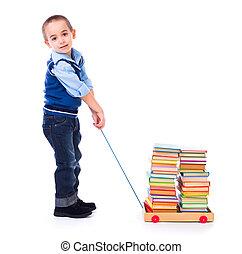 niño, tirar, libros, en, carro del juguete