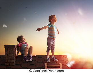 niño y niña, juego, en, el, techo