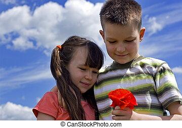 niños, con, flor