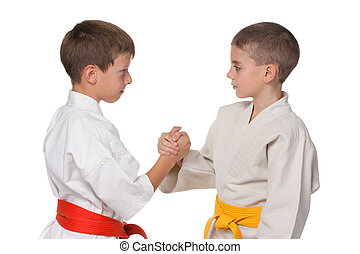 niños, kimono, apretón de manos