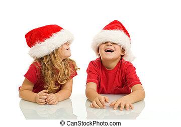niños, tener diversión, con, sombreros de navidad