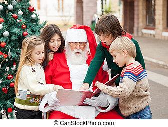 niños, y, santa claus, libro de lectura