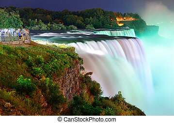 Niagara Falls in colors - Niagara Falls lit at night by...