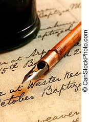 Nib Pen and Inkwell - Vintage nib pen and inkwell, on a page...