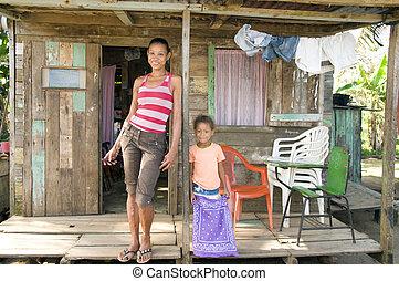 Nicaragua mother daughter clapboard house Corn Island -...