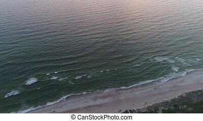 aerial view of sandy beach at sunset