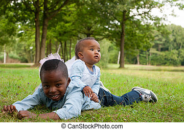 Nice african brother and sister - Happy little children are...