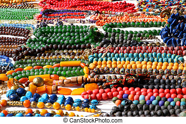 colorful African-style necklaces for sale at flea market