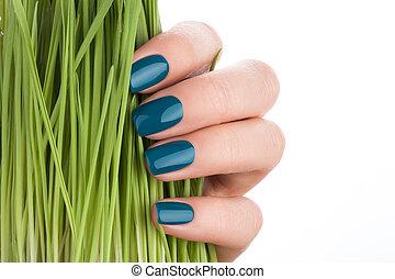 Beautiful and neat nails green closeup.