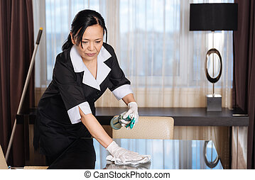 Nice Asian woman concentrating on her work - Personnel...