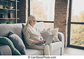 Nice attractive peaceful focused skilled gray-haired lady ...