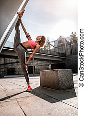 Nice attractive woman doing the splits in the air