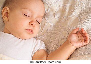 nice baby sleeping - nice newborn sleeps on a white bed