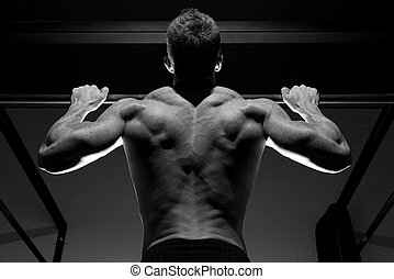 Nice back on a pull up - Close view of pull up in the gym