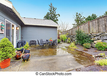 Nice back yard with large patio and chairs.