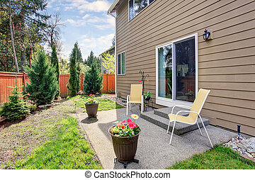 Nice backyard with concrete patio area.