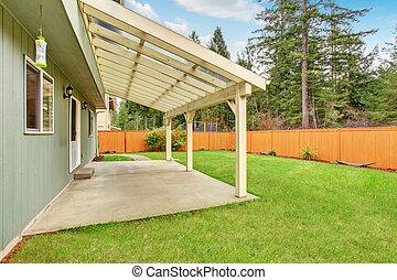 Nice backyard with covered patio.