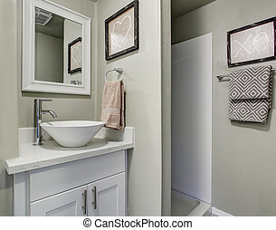 Nice bathroom with grey green walls and simple decor.