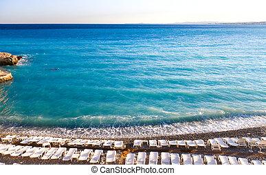 Nice beach with chaise-longue