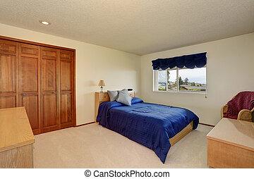 Nice bedroom in creamy tones with small bed, built in wardrobe