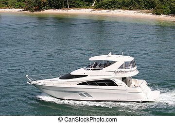 A nice white cabin cruiser on the water