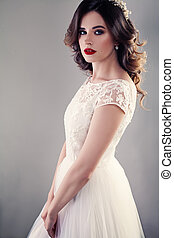 Nice Bride in White Wedding Dress, Pretty Girl Fiancee with Curly Hair and Makeup on Background
