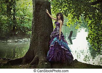 NIce brunette beauty wearing gorgeous dress