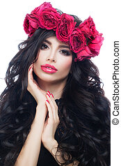 Nice Brunette Model Woman with Long Healthy Hair Wearing Pink Summer Wreath. Makeup, Hairstyle, Rose Flowers