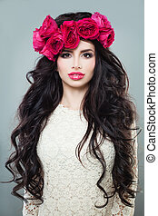Nice Brunette Woman with Long Permed Hair, Beautiful Makeup and Flowers Wreath