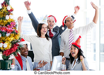 Nice business team punching the air to celebrate christmas ...