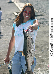 Nice Catch - Beautiful fisherperson holds up magnificent...
