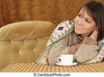 Nice Caucasian woman on a sofa