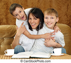Nice charming mom and sons sitting