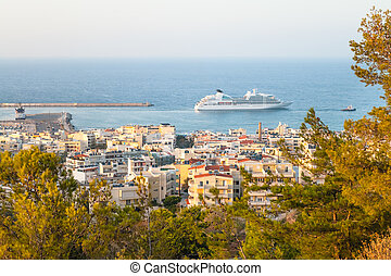 Nice city view on sea and big ship in Crete