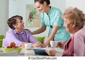 Nice conversation - Two older women having a nice...