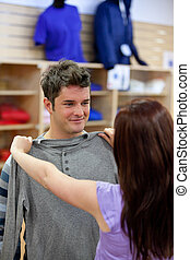 Nice couple choosing clothes
