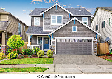 Nice curb appeal of two level house, mocha exterior paint...