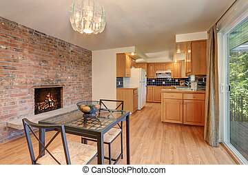 Nice dining room with hardwood floor and brick tile fireplace.