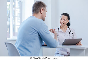 Nice doctor enjoying appointment in the hospital