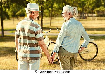 Nice elderly couple having a walk