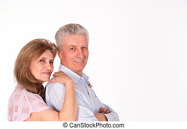 elderly couple on a white