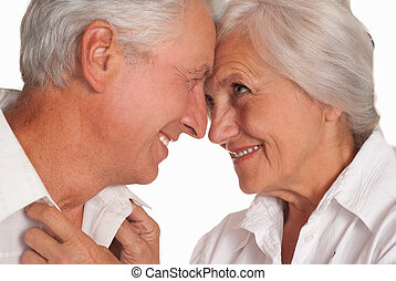 nice elderly couple together on a white