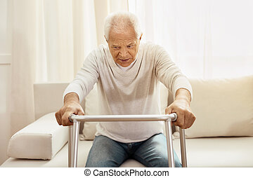 Nice elderly man using a walker