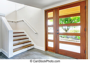 Nice entry way to home with carpet staircase and white interior